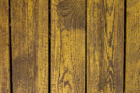 natural old wood texture yellow paint flakes background