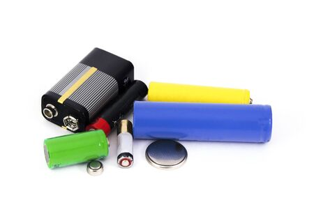 different types of batteries and accumulators color on white background isolated Stockfoto