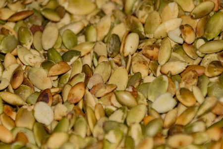 Pumpkin seeds background fried peeled green lot