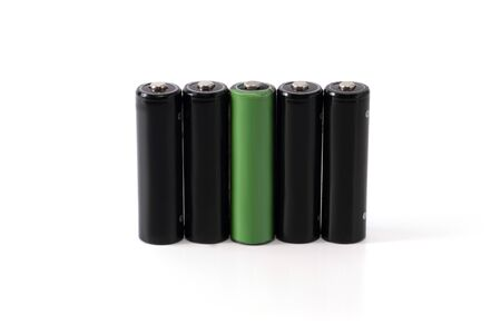 four black batteries, one is highlighted in green isolated