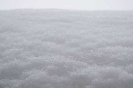 Snowy surface as background texture white winter day