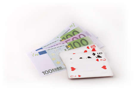 money playing cards dice on white background