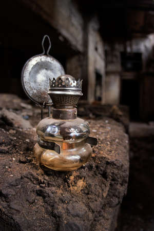kerosene lamp: Old kerosene lamp in an abandoned, gloomy, creepy building of an old factory