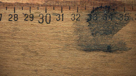 outworn: Dirty wooden ruler Stock Photo