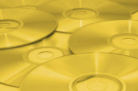 cds: Background of cds toned yellow.