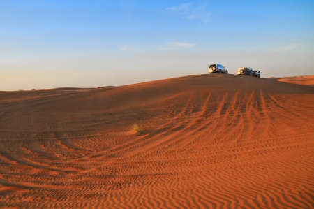 Jeeps on dune during desert safari in UAE, near Dubai.
