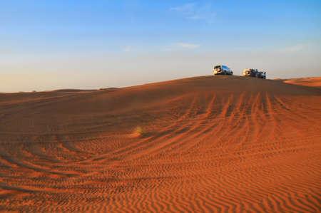 Jeeps on dune during desert safari in UAE, near Dubai.  photo