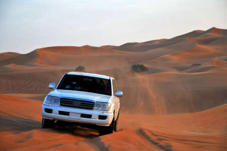 Jeep in dunes during safari near Dubai, UAE.