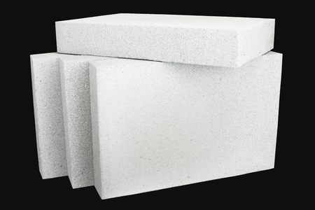 foamed: Lightweight foamed gypsum block isolated on black.