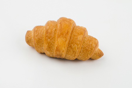 Delicious croissants with cherry jam on a white background.