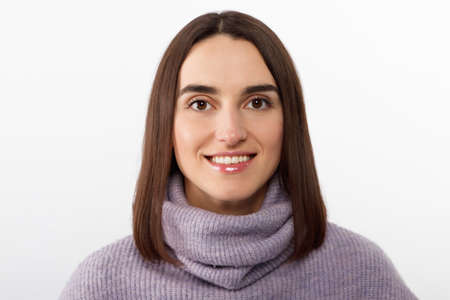 Close-up alluring happy smiling brunette woman in a purple sweater looking forward to exciting event, grinning joyfully express positivity and enthusiasm, glad take part interesting promo campaign. High quality photo