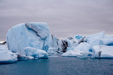 Icebergs in Jokulsarlon lagoon beneath Breidamerkurjokull glacier Sudhurland, Iceland Фото со стока - 129196040