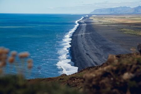 View of the beach near the cape Dyrholaey at the village of Vik in Iceland