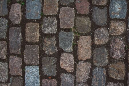 The texture of the old cobblestone and unusual stones. Patterned paving tiles cobblestone road for texture. Stockfoto - 129198676