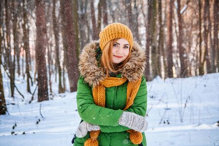 Young woman winter portrait. Close-up portrait of happy girl. Expressing positivity, true brightful emotions