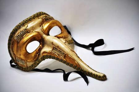 Golden festival mask of past times