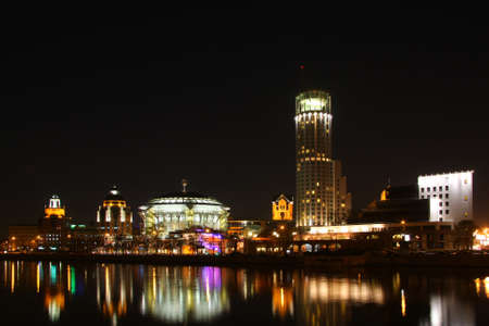 Night city. Business centre in river. Stock Photo