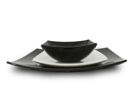 China dinner service. White and black empty plates. Stock Photo