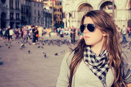 st  mark's square: Portrait of a pretty girl posing on St. Marks Square Piazza San Marco, Venice, Italy. Toned effect