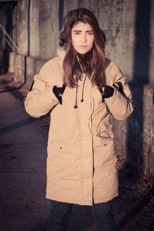 fur hood: Teenage girl outdoor wearing winter coat with the faux - fur hood . Toned effect