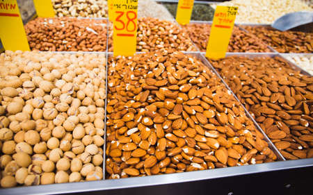 Variety of nuts at Mahane Yehuda market in Jerusalem. Food concept background.
