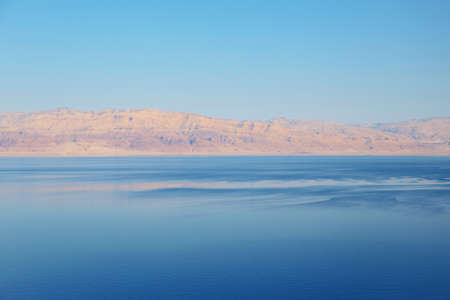 Beautiful view of salty Dead Sea shore with clear water. Ein Bokek, Israel.