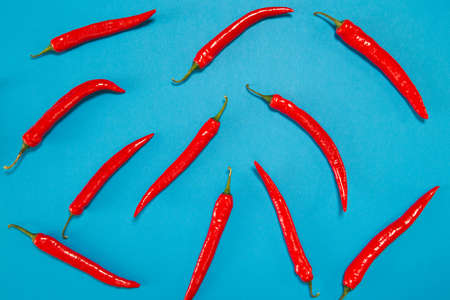 Creative chilli pepper background for posters, blogs, web design. Healthy food ingredient suitable for vegans and vegetarians