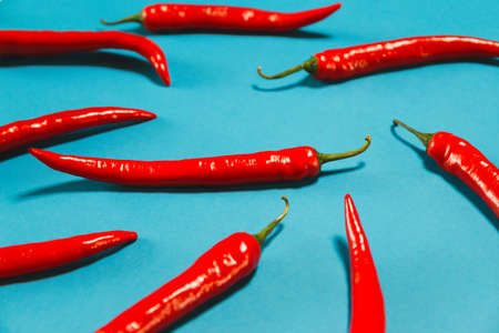 Creative chilli pepper background for posters, blogs, web design. Selective focus. Healthy food ingredient suitable for vegans and vegetarians