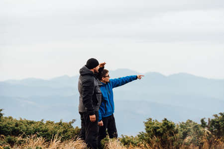 Meeting the dawn of tourists on top of the mountain. Stock Photo