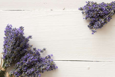 On the wooden table are purple bouquets of lavender flowers for herbarium. natural Provence herbs.