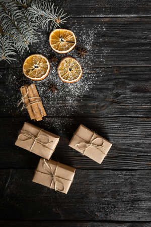 Christmas, homely atmosphere cosiness and warmth, round slices of orange, Christmas tree and gifts