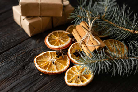 Wooden table with Christmas decorations, dried orange slices