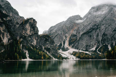 italy dolomite mountains lake lago di braies. Beautiful natural landscape, boats float on the water surface. Place for text Stock Photo