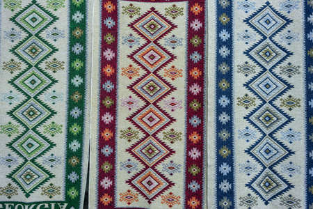 background, several classic Georgian carpets next to each other. Geometric patterns on the product. 스톡 콘텐츠
