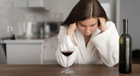 young beautiful woman in stress. Crisis and psychological fatigue. Alcohol is a solution to problems. Female alcoholism.