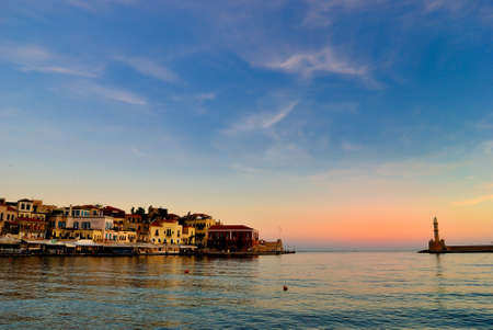 View of the port of Chania with the old city in Crete of Greece at sunrise