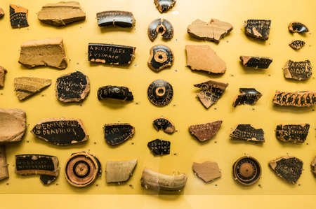 Ancient ceramics used for democratic voting in Athens the 5th century BC- Museum of ancient Agora in Athens, Greece Stock Photo