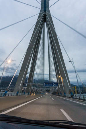 Driving through the Rio- Antirio cable stayed bridge in Achaia of Greece. It is the the worlds longest cable-stayed bridge Stock Photo