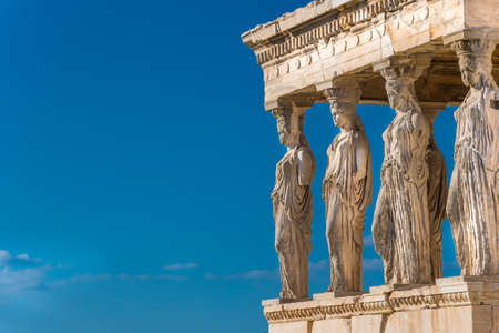 The Caryatids of the Erechtheion in Acropolis Athens Greece. A caryatid is a sculpted female figure serving as an architectural support taking the place of a column or a pillar supporting an entablature on her head