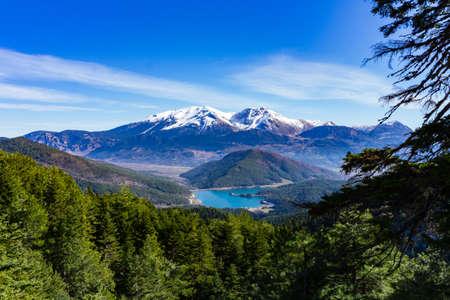 Panoramic view of Doxa lake and the snow covered Ziria mountain in Peloponnese Greece 版權商用圖片