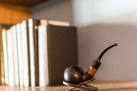 Smoking pipe on a bookshelf