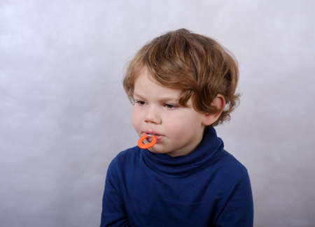 cute European boy with a Capa to correct the bite in your mouth Stok Fotoğraf