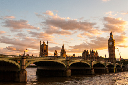 Big Ben and the Parliament with Westminster Bridge at sunset in London