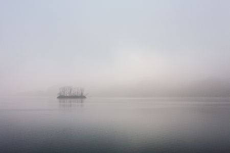 Pine Island at tranquil dawn in the Han River photo