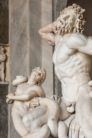 virgil: Roman statue of  Laocoon and his sons  in Vatican museum  Laocoon was a Trojan priest of Poseidon who warned against the Trojan Horse from the greeks
