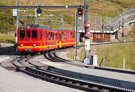 jungfraujoch: Tourist train in Kleine Scheidegg, Switzerland Editorial