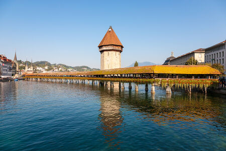 Luzern, Switzerland  Originally built in 1333, the Kapellbrucke bridge burnt down in 1993 and was rebuilt in its original form  The Water tower at one end of bridge remained undamaged  photo