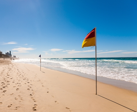 Flag on the Surfers Paradise Beach in Gold coast, Australia  photo