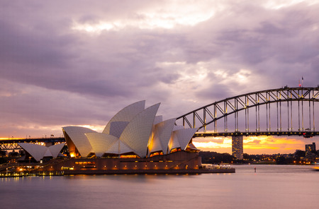 sydney opera house: Sydney, Australia - July 11, 2010; Sydney Opera House and the Harbour Bridge at dusk  Taken from Mrs  Macquarie s Point  Editorial