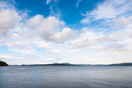 blue cloudy sky: Islands under blue cloudy sky